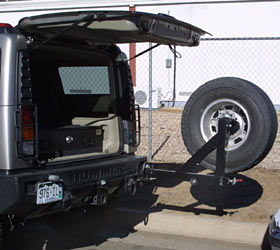 Tire Rack Locations on Tire Carrier Featuring A  No Lift  Hoist For Raising And Lowering The