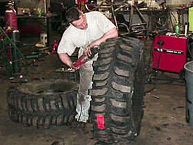 Dave cutting a tire